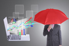Businessman with concept holding red umbrella Royalty Free Stock Photo