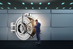 The businessman concerned about theft at banking vault door. Businessman concerned about theft at banking vault door Royalty Free Stock Photos