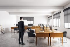 Businessman in concrete meeting room royalty free illustration
