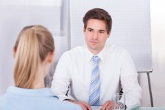 Businessman conducting interview Stock Images