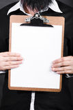 Businessman conducting survey with blank clipboard Royalty Free Stock Photos