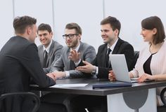 Businessman conducting a workshop with business team royalty free stock photography