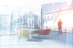 Businessman in conference room, graphs. Rear view of a businessman standing in a modern office waiting room. Panoramic windows. Graphs in the foreground. 3d Royalty Free Stock Photo