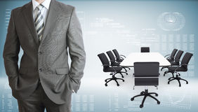 Businessman with conference table, chairs and Royalty Free Stock Images