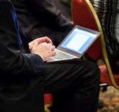 Businessman on conference with ultrabook Royalty Free Stock Photography