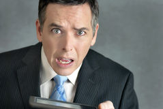 Businessman Confused By Tablet Stock Image