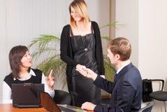 Businessman congratulate young businesswoman Stock Image