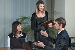 Businessman congratulate young businesswoman Royalty Free Stock Photos