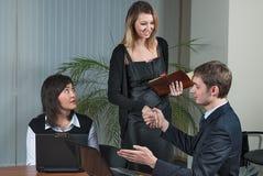 Businessman congratulate young businesswoman Royalty Free Stock Photos