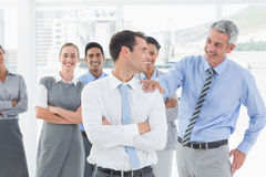 Businessman congratulating his colleagues Royalty Free Stock Images