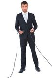 Businessman connecting cables together Royalty Free Stock Photo