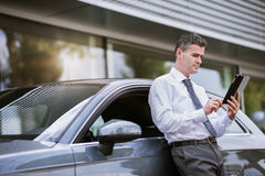 Businessman connecting with his tablet Royalty Free Stock Photos