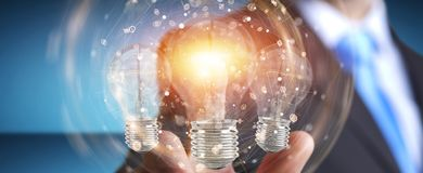 Businessman connecting modern lightbulbs with connections 3D ren Stock Photography