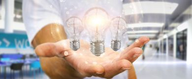 Businessman connecting modern lightbulbs with connections 3D ren Stock Images