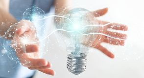 Businessman connecting modern lightbulbs with connections 3D ren. Businessman on blurred background connecting modern lightbulbs with connections 3D rendering Stock Images