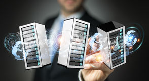 Businessman connecting servers room data center 3D rendering. Businessman on blurred background connecting servers room data center 3D rendering Royalty Free Stock Photos