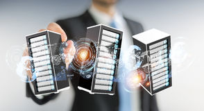 Businessman connecting servers room data center 3D rendering. Businessman on blurred background connecting servers room data center 3D rendering Royalty Free Stock Photo