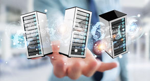 Businessman connecting servers room data center 3D rendering. Businessman on blurred background connecting servers room data center 3D rendering Royalty Free Stock Image