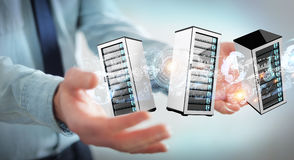 Businessman connecting servers room data center 3D rendering. Businessman on blurred background connecting servers room data center 3D rendering Stock Photography