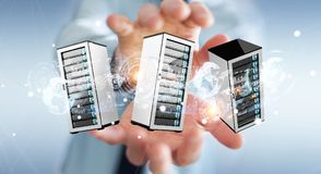 Businessman connecting servers room data center 3D rendering. Businessman on blurred background connecting servers room data center 3D rendering Stock Photos