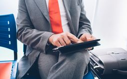 Businessman connecting with a tablet Royalty Free Stock Photography