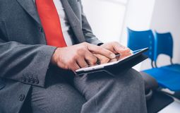 Businessman connecting with a tablet Stock Photos