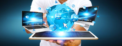Businessman connecting tech devices Stock Photography