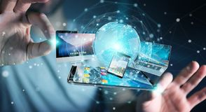 Businessman connecting tech devices and icons applications 3D re. Businessman connecting tech devices and icons applications with each other 3D rendering Stock Photo