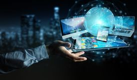 Businessman connecting tech devices and icons applications 3D re. Businessman connecting tech devices and icons applications with each other 3D rendering Royalty Free Stock Images