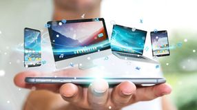 Businessman connecting tech devices and icons applications 3D re. Businessman connecting tech devices and icons applications with each other 3D rendering Royalty Free Stock Photo
