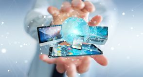Businessman connecting tech devices and icons applications 3D re. Businessman connecting tech devices and icons applications with each other 3D rendering Stock Image