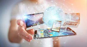 Businessman connecting tech devices and icons applications 3D re. Businessman connecting tech devices and icons applications with each other 3D rendering Royalty Free Stock Image