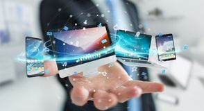 Businessman connecting tech devices and icons applications 3D re. Businessman connecting tech devices and icons applications with each other 3D rendering Stock Photography