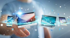 Businessman connecting tech devices and icons applications 3D re. Businessman connecting tech devices and icons applications with each other 3D rendering Royalty Free Stock Photography