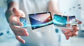 Businessman connecting tech devices and icons applications 3D re. Businessman connecting tech devices and icons applications with each other 3D rendering Stock Images