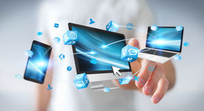 Businessman connecting tech devices and icons applications 3D re Royalty Free Stock Photography