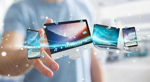 Businessman connecting tech devices and icons applications 3D re. Businessman connecting tech devices and icons applications with each other 3D rendering Stock Photos