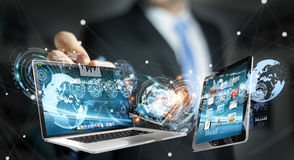 Businessman connecting tech devices with a pen 3D rendering Stock Photo