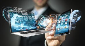 Businessman connecting tech devices with a pen 3D rendering. Businessman on blurred background connecting with a pen 3D rendering Stock Photography