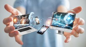Businessman connecting tech devices to each other 3D rendering. Businessman on blurred background connecting tech devices 3D rendering Royalty Free Stock Image