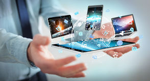 Businessman connecting tech devices to each other 3D rendering Royalty Free Stock Images