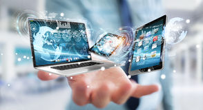 Businessman connecting tech devices to each other 3D rendering Stock Photo