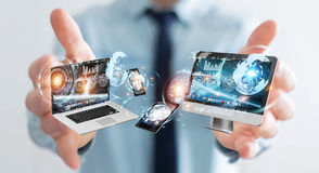 Businessman connecting tech devices to each other 3D rendering Stock Images