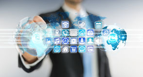 Businessman connecting worlds to icons and applications software Royalty Free Stock Photography