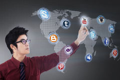 Businessman connects to internet application. Businessman connects to social media application Royalty Free Stock Photos