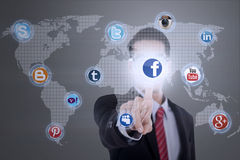Businessman connects to social media Stock Photography