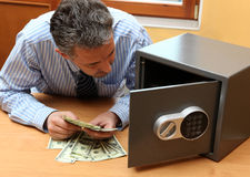 Businessman considers money Stock Images