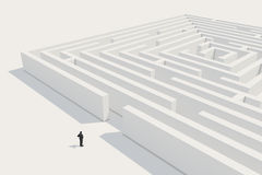 Businessman considers to enter maze. Businessman is thinking about entering the maze. High resolution 3d render with global illumination Royalty Free Stock Image