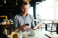 Businessman constantly working. Businessman constantly busy and working royalty free stock images