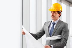 Businessman in construction helmet Royalty Free Stock Image